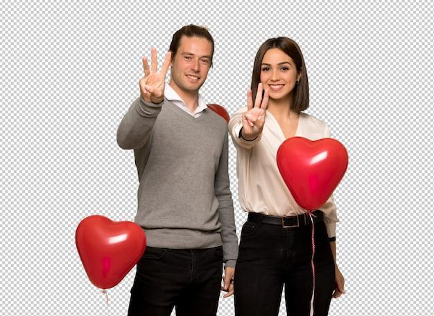 Paar in gelukkige valentijnskaartdag en drie tellen met vingers