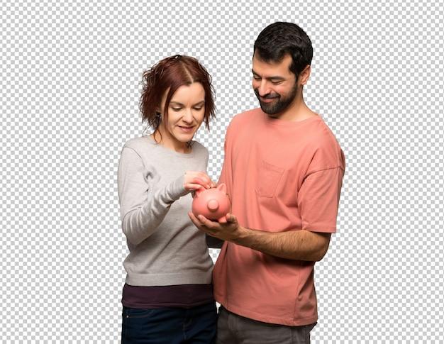 Paar in valentijnskaartdag die een spaarvarken neemt