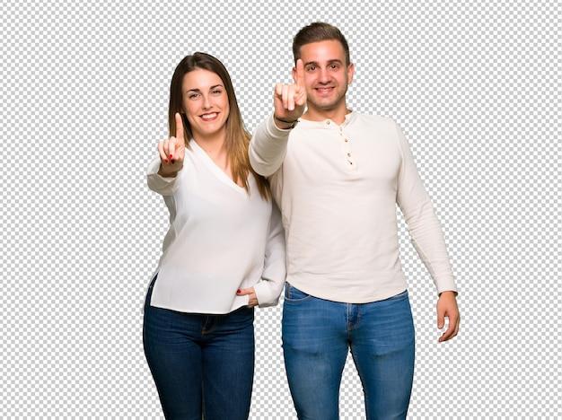 Paar in valentijnskaartdag die en een vinger toont opheft