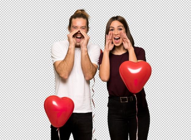 Paar in valentijnskaartdag die en iets schreeuwen aankondigen