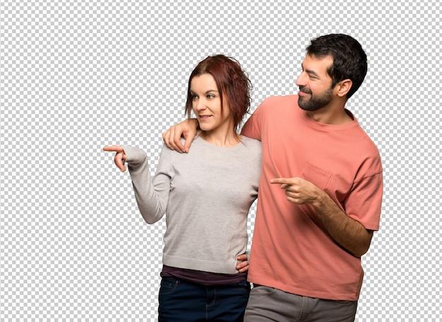 Paar in valentijnskaartdag die vinger aan de kant richten