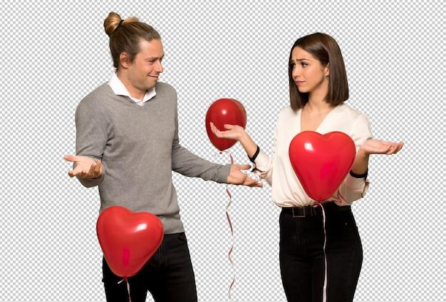 Paar in valentijnskaartdag ongelukkig en gefrustreerd met iets omdat iets niet begrijp