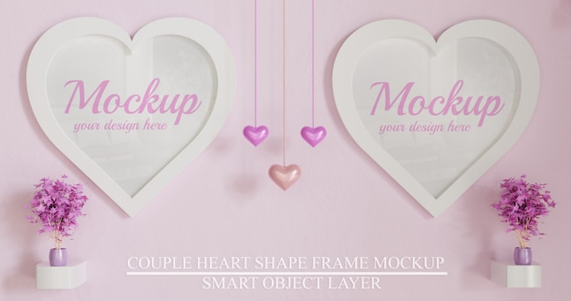 Paar witte hart vorm frame mockup op roze muur