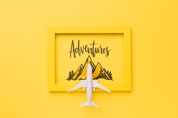 Palabra aventuras sobre marco con montaña y avión