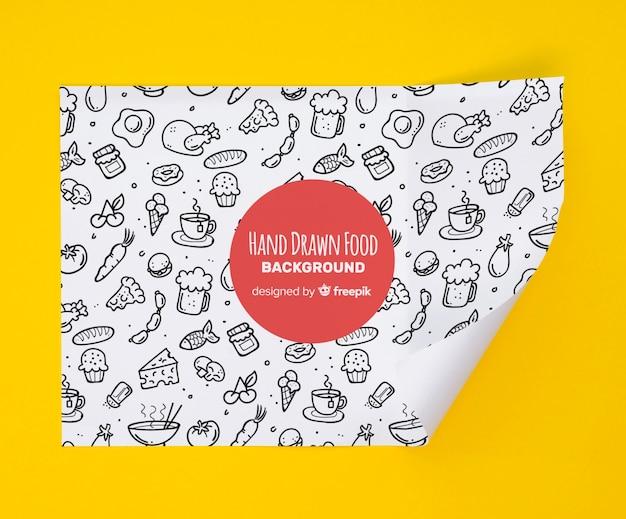 Papel de geometría con alimentos dibujados a mano.