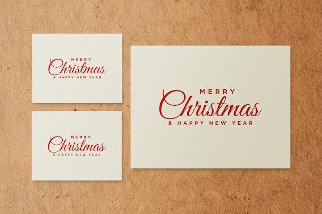 Papieren wenskaartmodel met kerstelementen psd