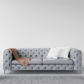 Pared vacía con elegante sofá