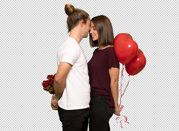 Pareja en el día de san valentín con un símbolo de corazón y globos