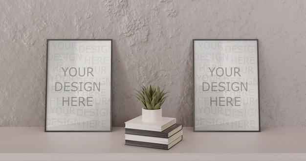 Pareja maqueta marco negro de pie sobre la mesa blanca con libros y suculentas. marco horizontal