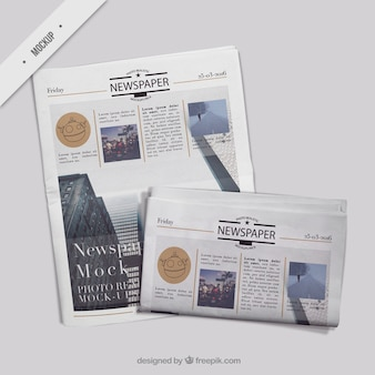 Periódico doblado con portada de periódico