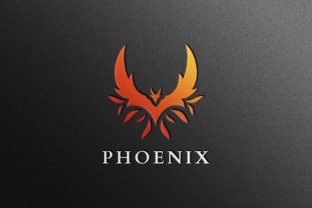 Phoenix logo mockup in zwart geperst papier