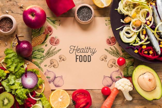 Piatto laici di cibo sano con il mockup di carta