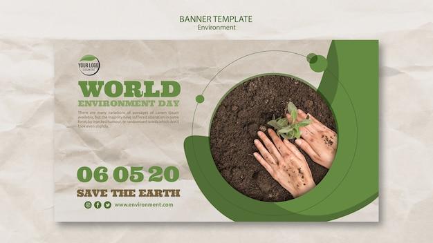 Plantilla de banner del día mundial del medio ambiente con manos y planta