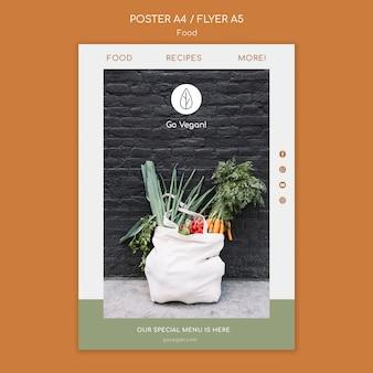 Plantilla de cartel vertical para comida vegana