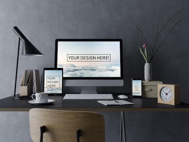 Plantilla de diseño de mock up de escritorio, tableta y teléfono inteligente premium con pantalla editable en interior negro en el lugar de trabajo