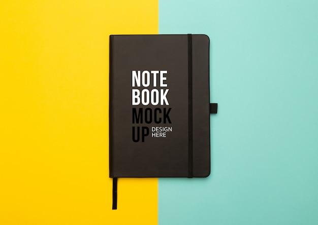 Plantilla de maqueta de cuaderno negro vista plana o vista superior.
