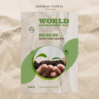 Plantilla de póster del día mundial del medio ambiente con manos sosteniendo la planta