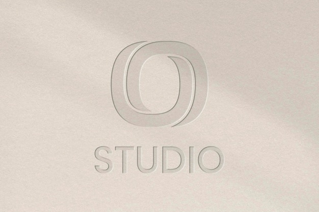 Plantilla psd de logotipo de empresa de estudio en textura de papel grabado