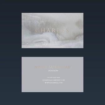 Plantilla de tarjeta de visita de lujo psd en tono dorado y gris con vista frontal y trasera plana