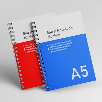 Plantillas de diseño de maquetas de bloc de notas de cuaderno de tapa dura en espiral de dos oficinas premium en vista frontal