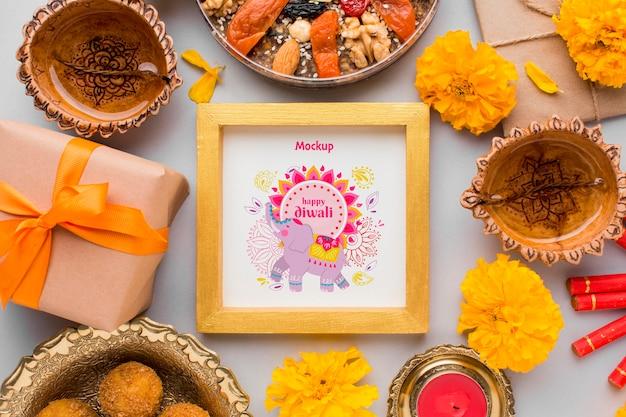 Plat lag gelukkig diwali festival mock-up met bloemen