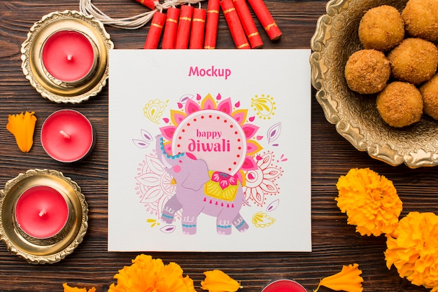 Plat lag gelukkige diwali festival mock-up rode kaarsen