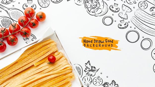 Plat lag ongekookte pasta met tomaten