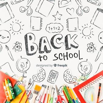 Plat lag schoolbenodigdheden met tekeningen