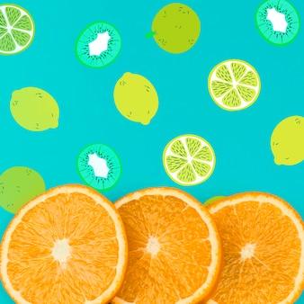 Plat leggen zomer mockup met copyspace en stukjes sinaasappel