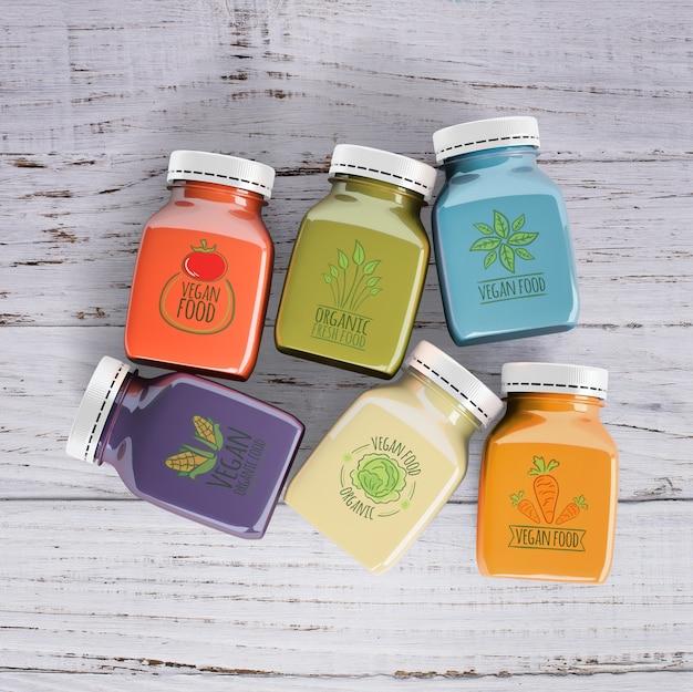 Platliggende smoothies gemaakt van verschillende soorten fruit