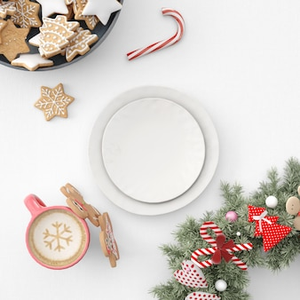 Platos, galletas y chocolate caliente en la mesa navideña