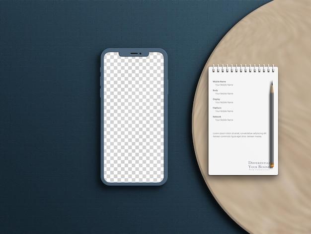 Pocket notebook en mobiele telefoon mockup
