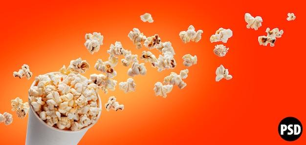 Popcorn in kartondoos op rood wordt geïsoleerd dat