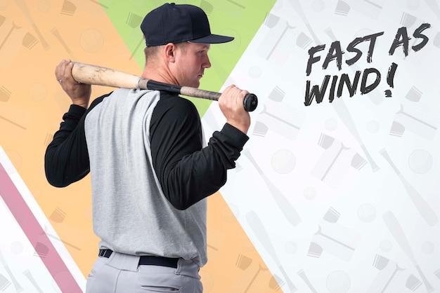 Portret dat van honkbalspeler een knuppel houdt