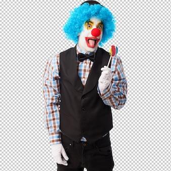 Portret van een grappige clown die een lolly houdt