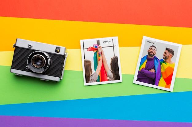 Posa piatta della fotocamera con immagini per orgoglio