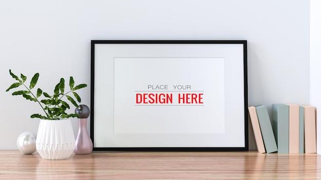 Poster frame mockup aan de muur met plant Gratis Psd