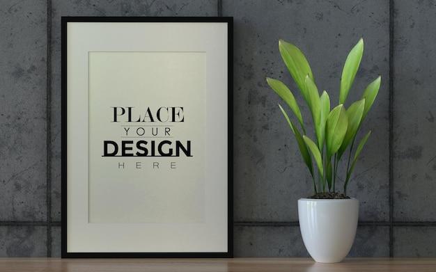 Poster frame mockup aan de muur met plant