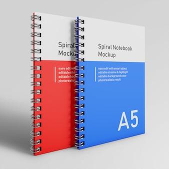 Premium due modelli di progettazione del blocco note a spirale del raccoglitore a spirale del raccoglitore di bussiness nella vista di prospettiva anteriore