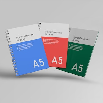 Premium three office hard cover spiraalbinder notebook mockups ontwerpsjablonen vliegen in vooraanzicht