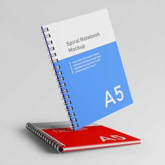 Premium twee zakelijke hardcover spiraalbinder notebook mock up ontwerpsjabloon in vooraanzicht