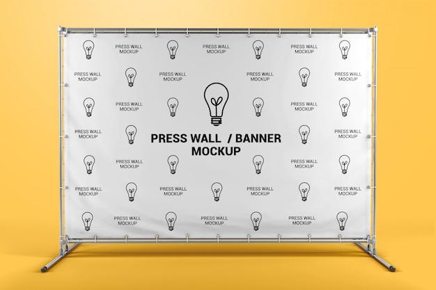Presione la maqueta de la vista frontal del banner de pared