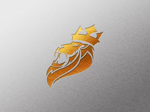 Primo piano sul mockup del logo impresso in lamina d'oro