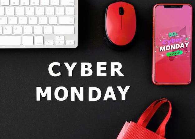 Promoción de cyber monday de vista superior con fondo y maqueta de teléfono