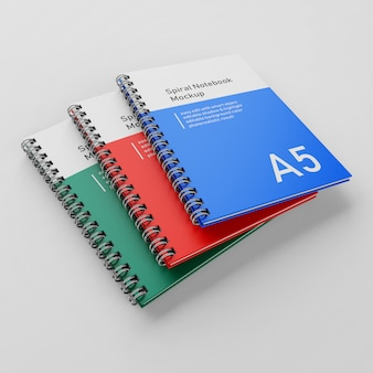 Realistische drie corporate hard cover metalen spiraal a5 binder notebook mock up ontwerpsjabloon in perspectief bekijk