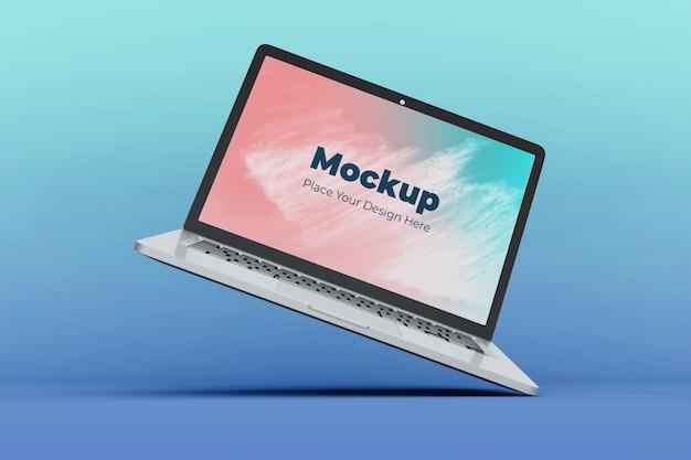 Realistische drijvende laptop scherm mockup ontwerpsjabloon