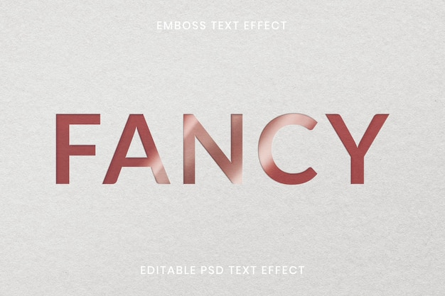 Reliëf teksteffect psd bewerkbare sjabloon op wit papier textuur achtergrond