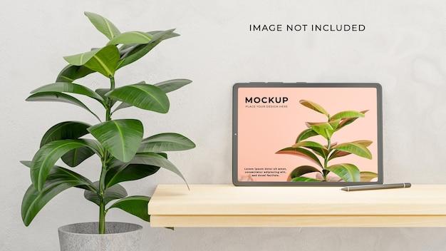 Render 3d de tableta con planta en maqueta de fondo de hormigón