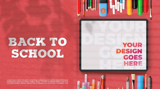 Ritorno a scuola mockup con materiale scolastico e tablet