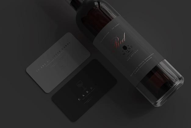 Rode wijnfles met visitekaartje mockup